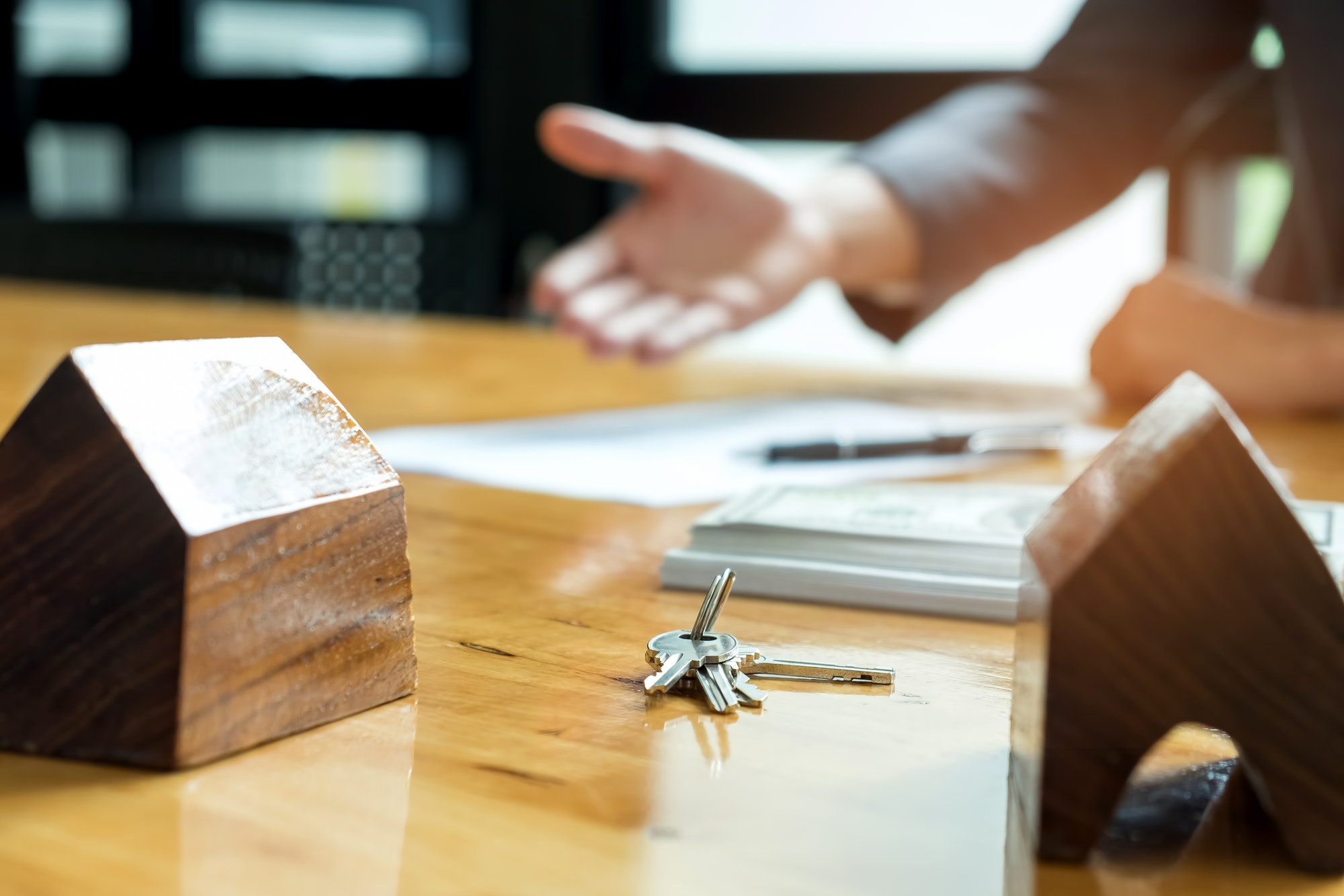 Sales are selling home. There are documents with the replica and